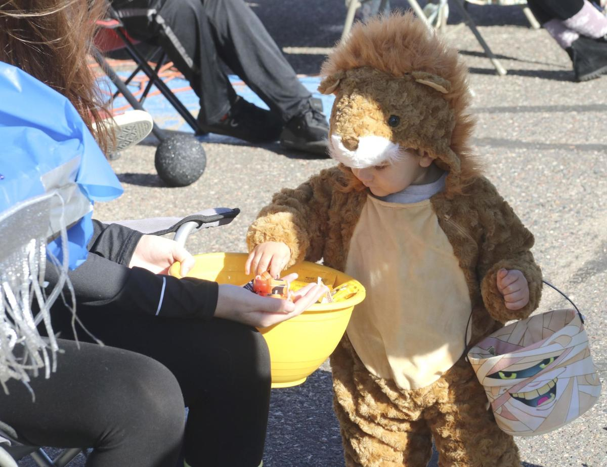 Costumed kids get a jump start at trick or treating
