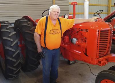 The pull of a tractor: Nostalgia draws man to annual threshing show