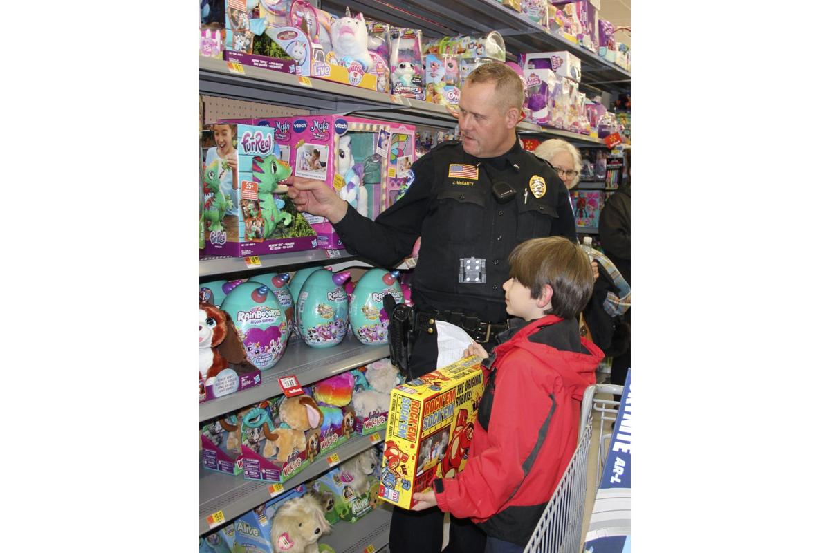 Kids shop with a cop and a smile