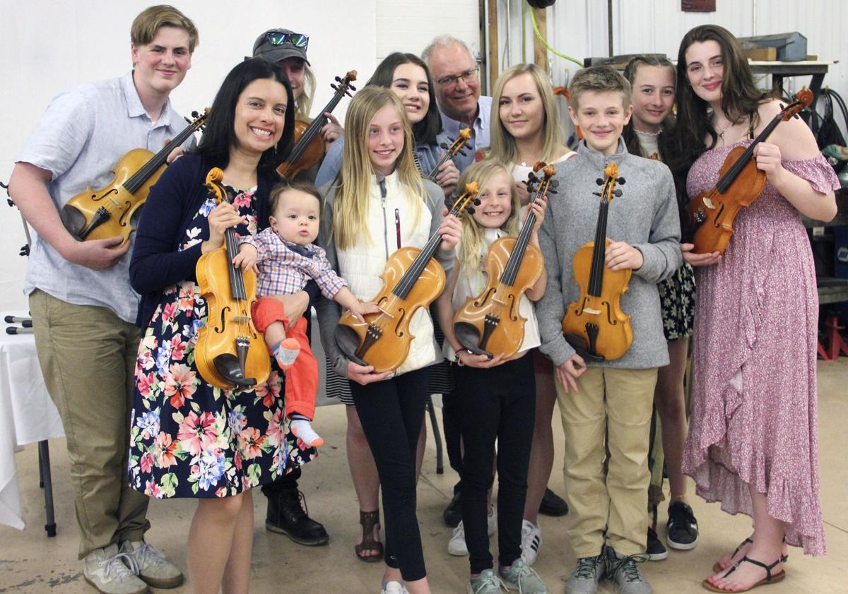 Grandfather's labor of love yields 10 violins