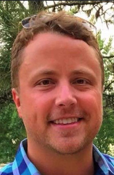 Travis J. Blomquist