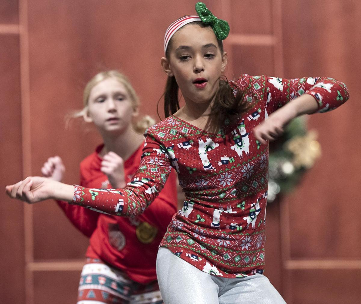 Kids put on their holiday dancing shoes during Christmas program