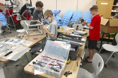 Robotics teams work around 'pause'