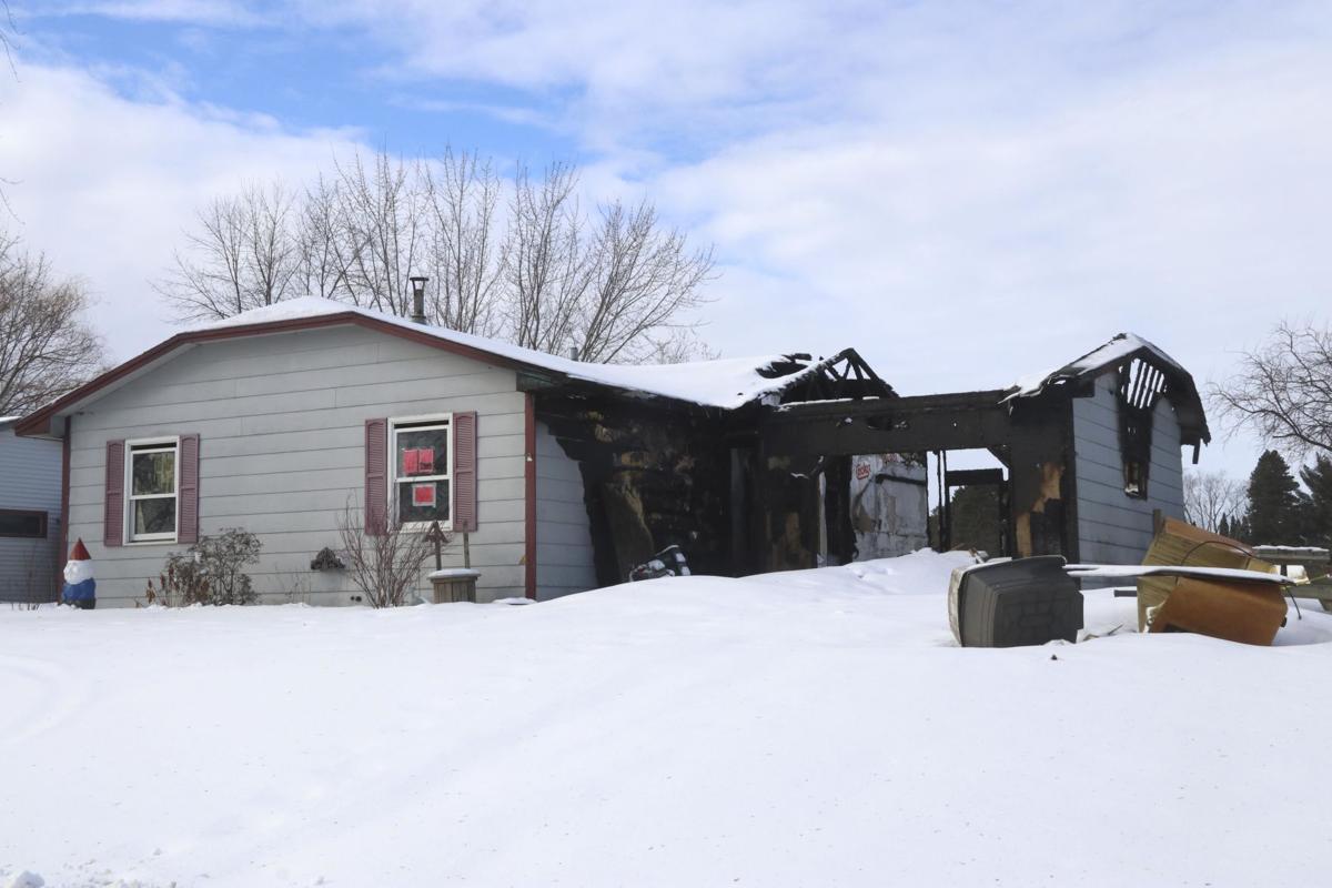 Council begins process of demolishing burned  Cambridge house
