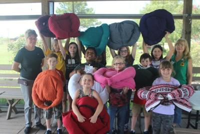 Campers donate homemade animal beds to humane society