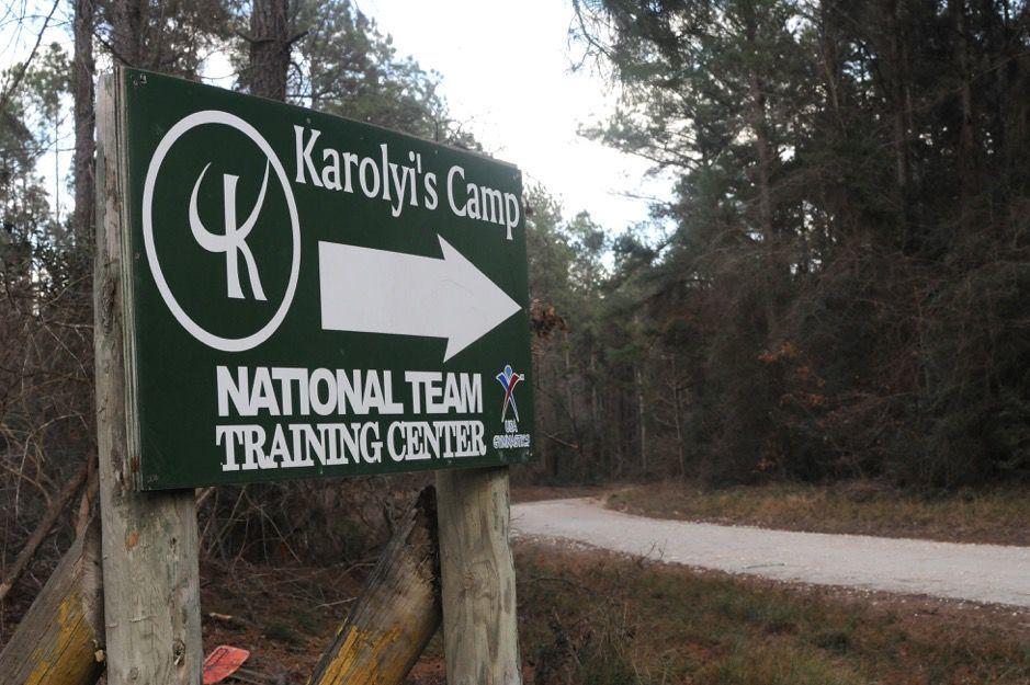 Signs mark the way to the Karolyi Ranch