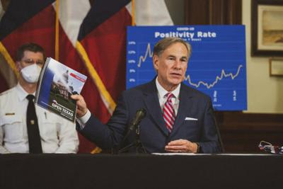 Governor urges masks but no new steps as cases rise in Texas