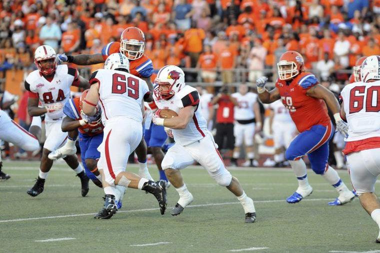 Cardinals running back Kade Harrington finds a hole in the Bearkats line during the first quarter at Bowers Stadium on Saturday night. Harrington gashed the Bearkats for 230 yards on the ground and 83 in the air picking up three touchdowns to beat Sam Houston 49-46 in both teams conference opener. (Joshua Yates/The Huntsville Item)