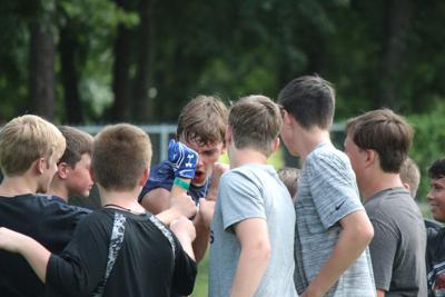 Campers hone skills, catch glimpse into AOA football program