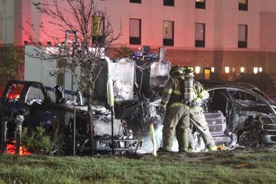 Truck fire damages several vehicles in hotel parking lot