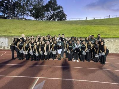 Buddies Club performs at Hornet football game