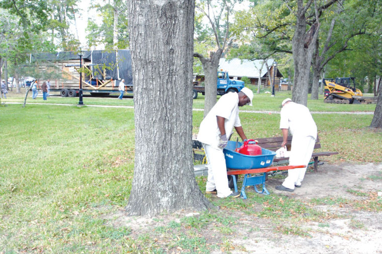 texas department of criminal justice inmates work to prepare an area for the new bear bend cabin at the sam houston memorial museum