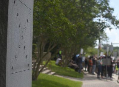 Public debate continues over Confederate monument