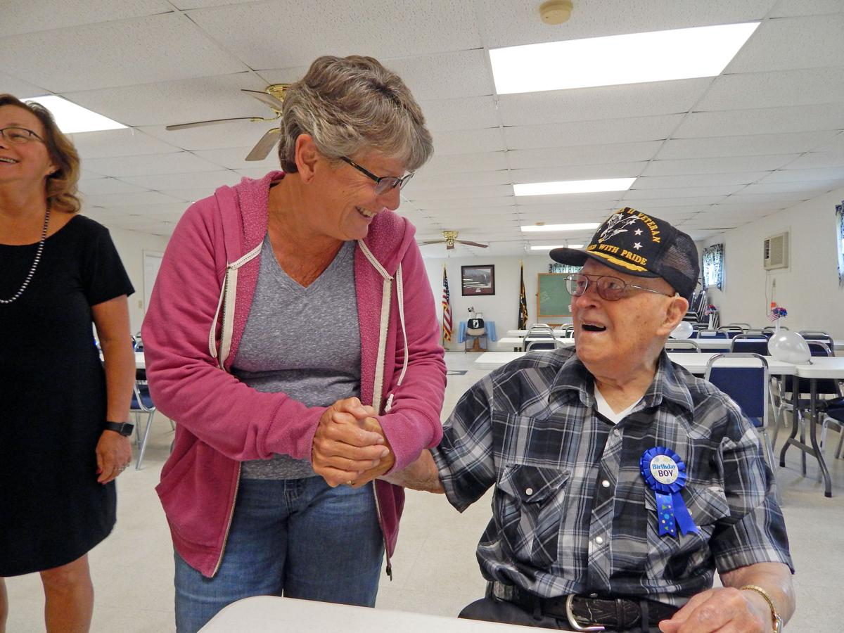 Bob Stein, of Van Etten, greets Debbie Greene, of Spencer, at his 99th birthday party Aug. 24.