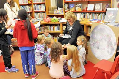 Children gather 'round to read a book at Southworth Library in Dryden.