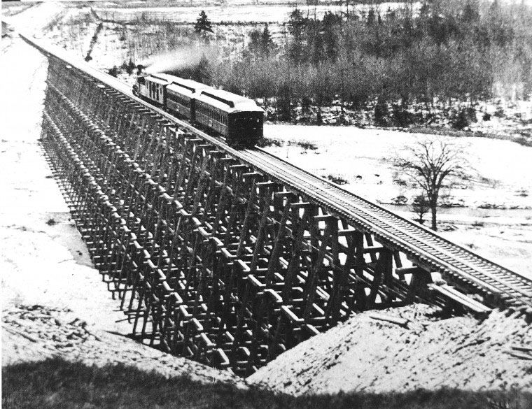 A train moves over a rail trestle in Brooktondale.