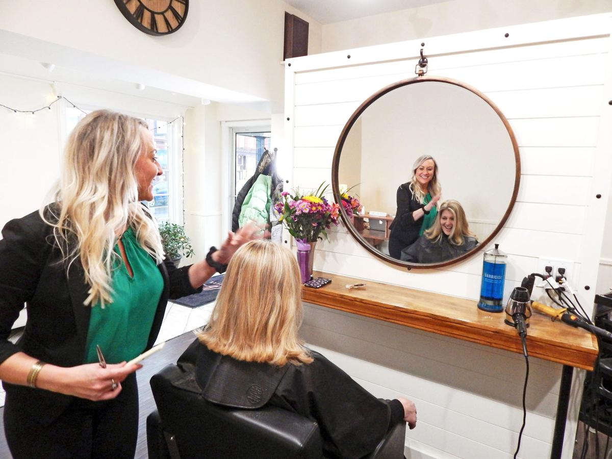 Jill George, owner of La Belle House of Beauty, puts the finishing touches on longtime client Julie Tinkham, of Cortland.