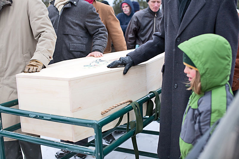 Mourners carry the casket of their beloved during a funeral at Greensprings Natural Cemetery in Newfield. (Photo: Provided)
