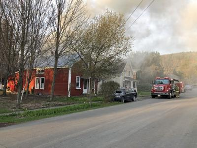 The first Spencer fire engine on the scene at the April 21 house fire at 20 Liberty St. found smoke billowing from the second floor. Flames were visible shortly afterward.