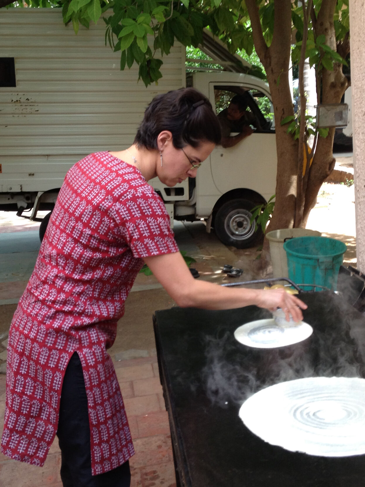 Learning how to make dosa in India.jpeg