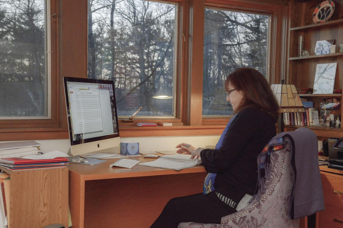 Gertrude Noden, Founder of Words Into Deeds at work in her home office recently.