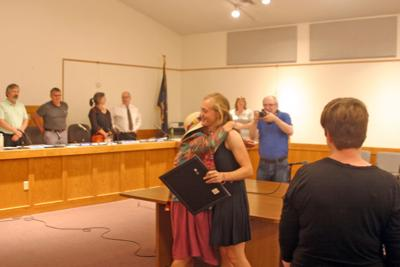 Ellen Howell (left) embraces Town Councilwoman Andra Benson June 19 after receiving a certificate from the Town Board for performing in the All Eastern Honors Ensemble this spring.