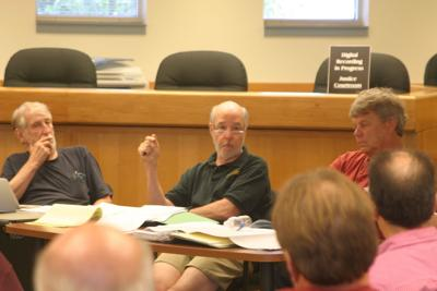 Town of Dryden Planning Board member Joseph Wilson (center) speaks during a meeting on July 25. The Planning Board will interview three finalists for the consultant position that will assist the Town Council in updating the town's comprehensive plan.