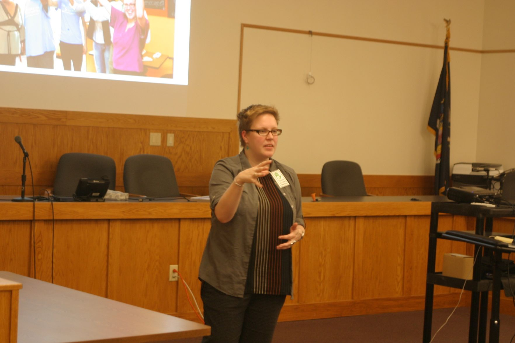 Claire Muller, lead community organizer at Toxics Action Center, speaks at a special meeting at the Lansing Town Hall on May 29.