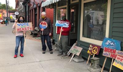 Left to right: Amy Puryear and Alan Vogel, of Trumansburg, and Mike Pitzrick, of Dryden, gathered in Trumansburg last week to make signs for #PaintTheVote.