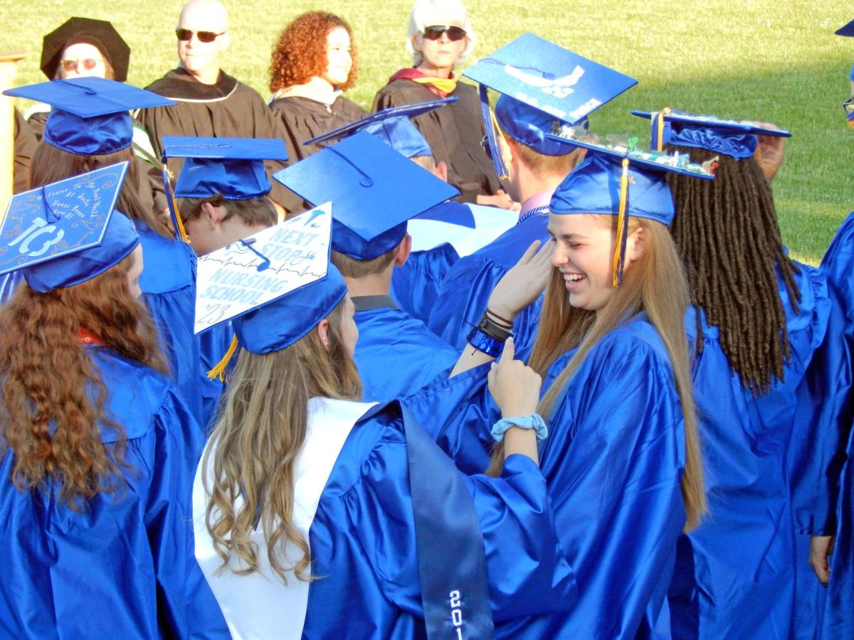 Charles O. Dickerson high school graduates congratulate each other at the conclusion of their commencement ceremony June 27.