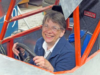 Carol Henry, Candor Town and Village Historian, who climbed into a go-cart designed and built by one of Lindridge's classes.