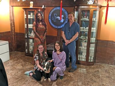 Janette Dewey (top left) and Curtis Dewey (top right), along with Kayla Morley (bottom left), the Dewey's dog Una and Yuki Guan.