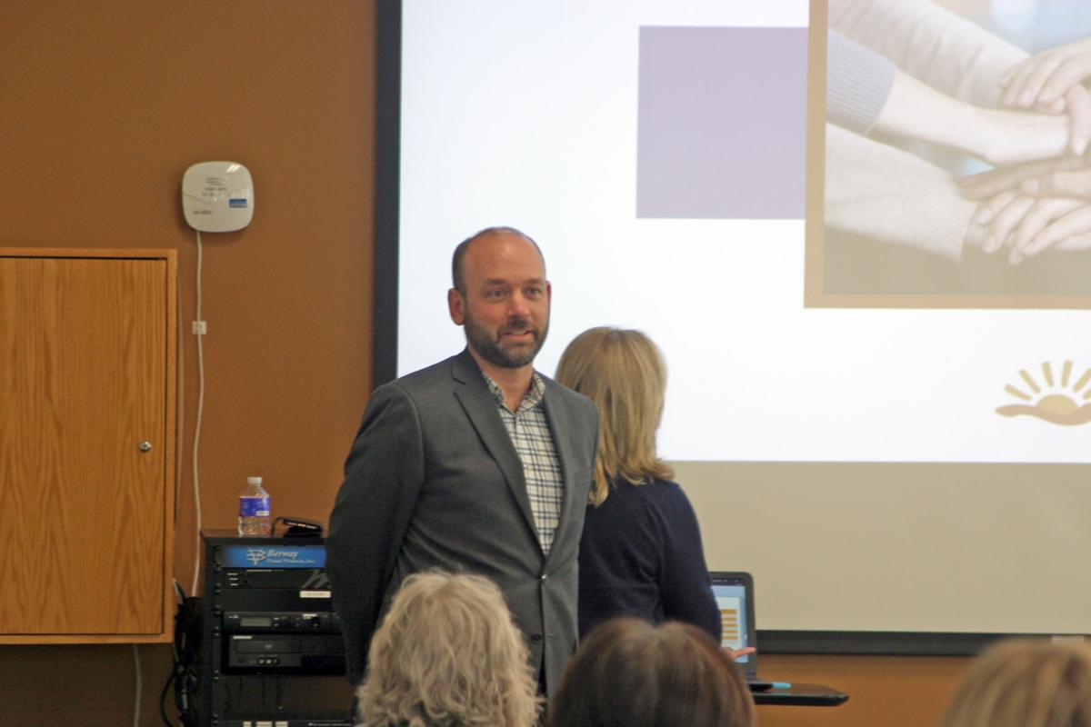 Dr. John-Paul Mead speaks in front of a crowd during the open house for the Open Access Center on May 7. Mead is the center's medical director.