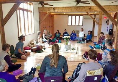 Students at Yoga Farm in Lansing.
