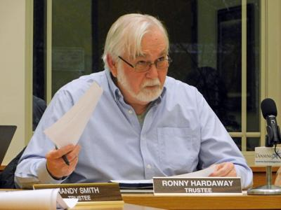 Village Trustee Ronny Hardaway (above), along with the rest of the village board, agreed that it would be best to review a plan for changing the zoning density of a 25-acre property on Uptown Road before voting on the proposed change.
