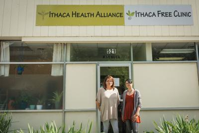Luz Rivera (Clinic Coordinator) and operations manager Olivia Knewstub, outside the Ithaca Free Clinic.