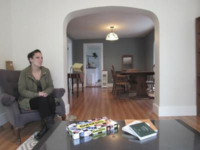 Liddy Bargar of Catholic Charities in their new residence, A Place to Stay