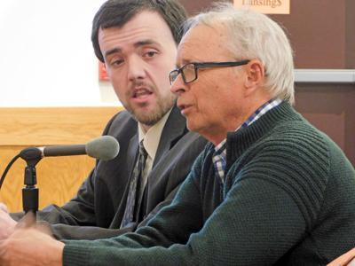 Rocco Lucente (left) looks on to Lawrence Fabbroni (right), who is speaking in front of the Town of Lansing Planning Board about a waiver request for the Village Solar project.