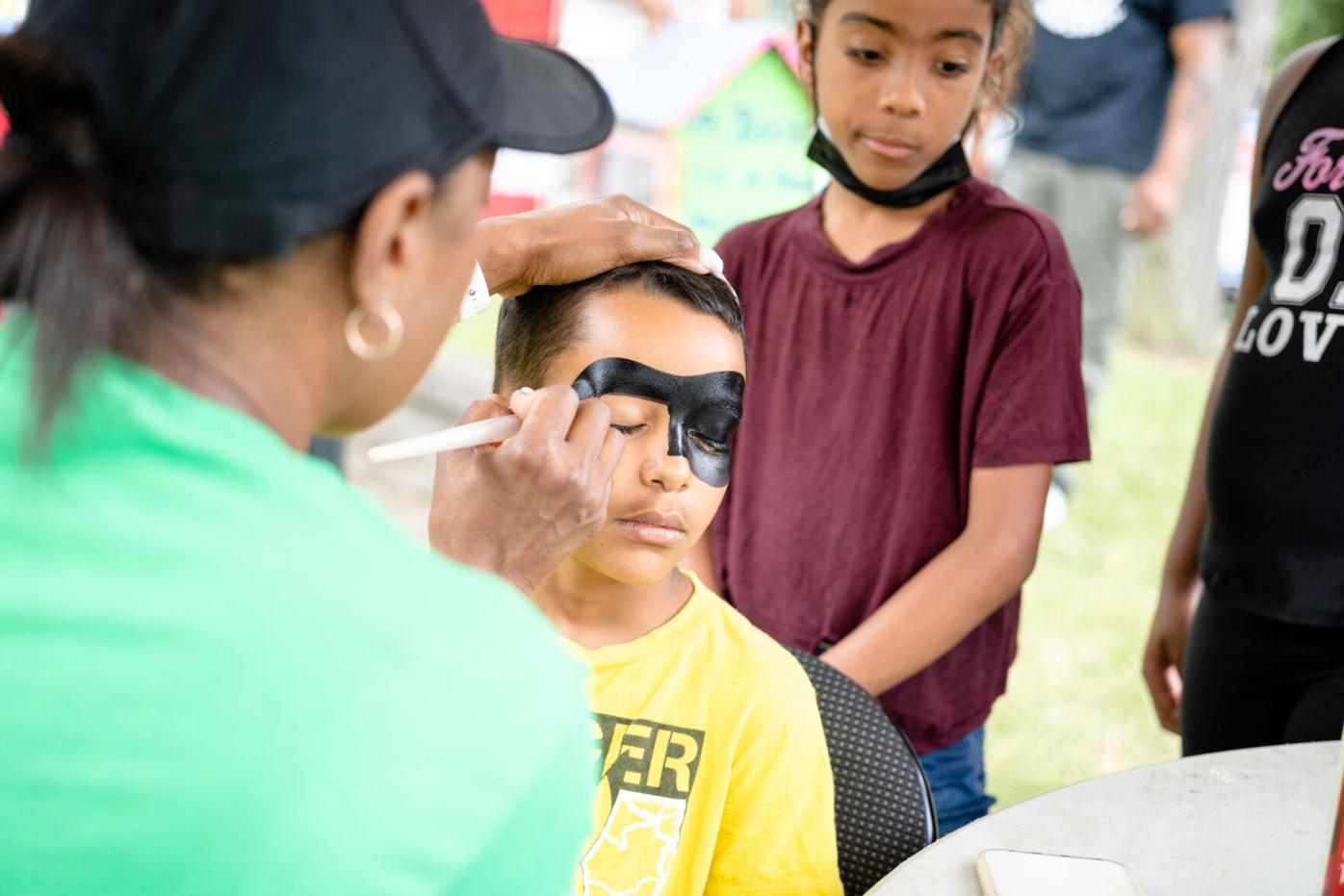 A child getting his face painted