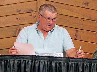 Mayor Chris Neville at a Groton Village Board of Trustees meeting on July 20.