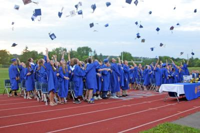 The Lansing High School graduating class of 2019 toss their caps in the air after officially graduating during the ceremony on June 28.