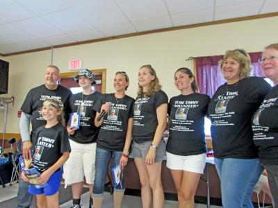 Team Timmy members at a benefit in memory of Captain Tim Neild Aug. 3.