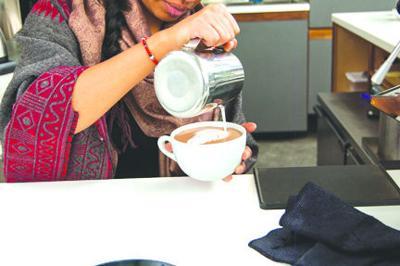Press Cafe staff making hot chocolate
