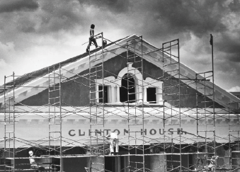 A picture of scaffolding outside of Cayuga Street's Clinton House during one of its renovations. The building is still in use, housing New Roots Charter School now.