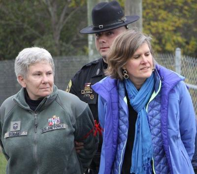 Colleen Boland, left, and Sandra Steingraber, right, being arrested for protesting at the site of a potetial expansion of Crestwood-Midstream.