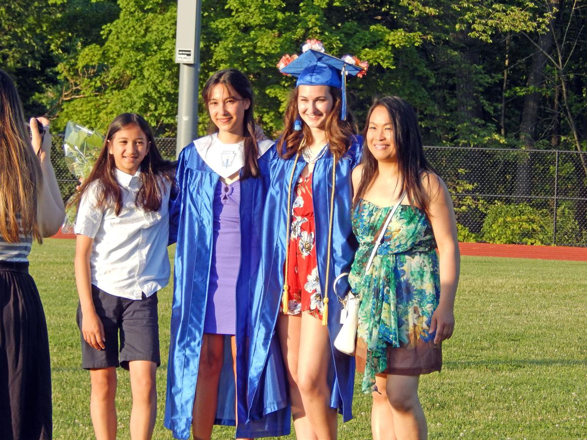 Class of 2019 Charles O. Dickerson graduates Lenna Georgiadis (second from left) and Elise Murray pose with Georgiadis' sister, Skye Georgiadis (far left), and mother, Yupawan Georgiadis, after graduation June 27.