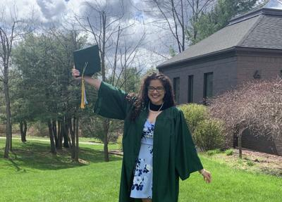 Monique Kapur-Mauleon posing after earning her two degrees from TC3.