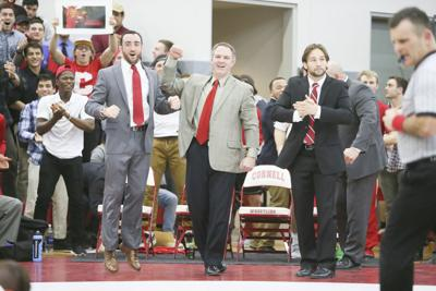 Cornell Wrestling Coach Rob Koll reacts after another successful match during the program's long run of dominance.