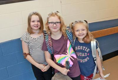 Lilly-Anne Richmond, McKenzie Hathaway and Miley Hathaway at South Seneca Elementary School on their first day of school, Sept. 4.