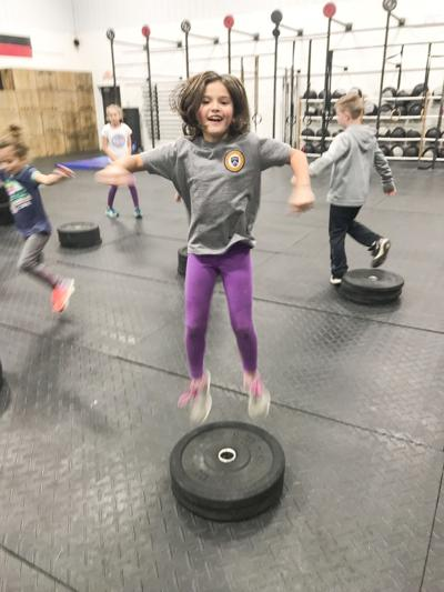 Kids play during a recent CrossFit Kids program at the local CrossFit Pallas gym.